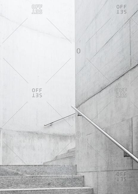 Gray granite stairway with handrails