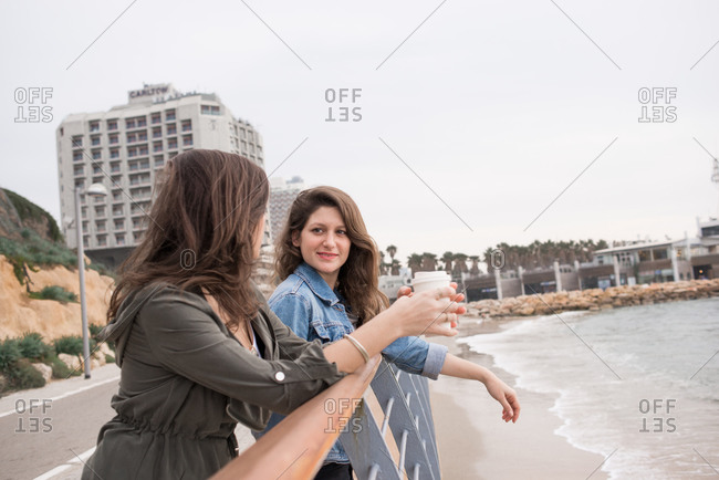 Young women leaning on a waterfront railing