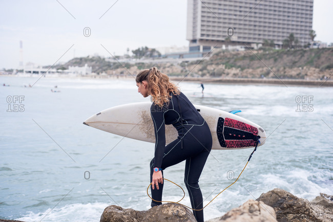Surfer preparing to jump into the water