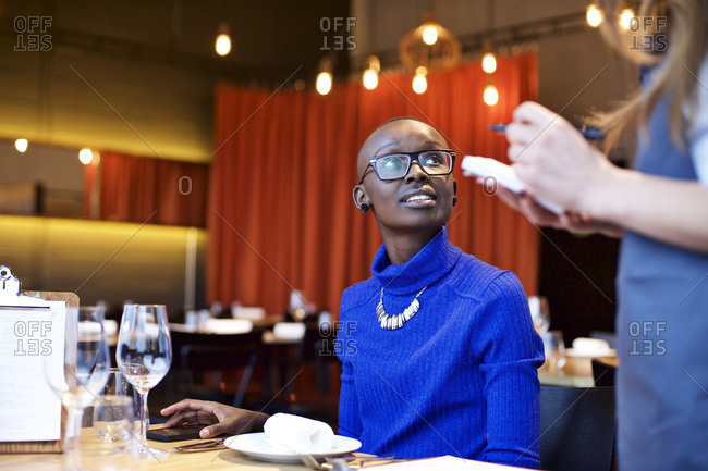 Waitress writing down woman's order