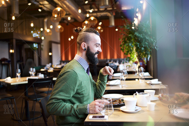 Man eating a meal in a restaurant