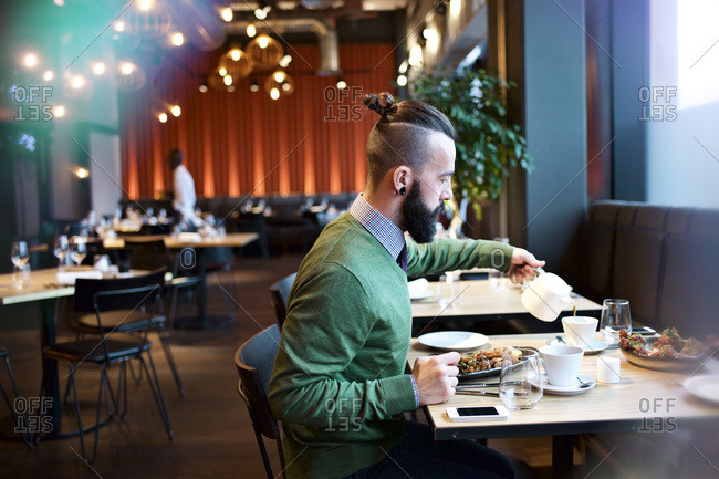 Man pouring tea in a restaurant