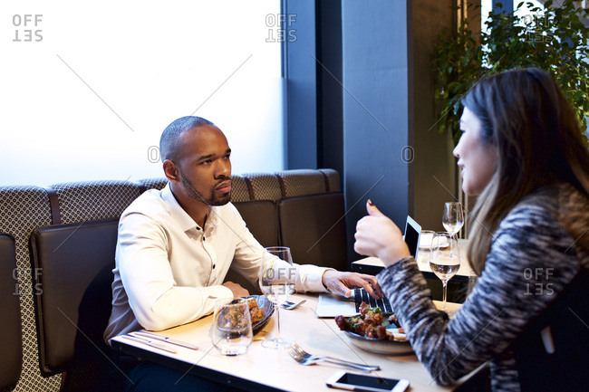 Couple talking over appetizers in a restaurant