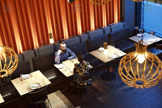 High angle view of couple sitting together in a restaurant