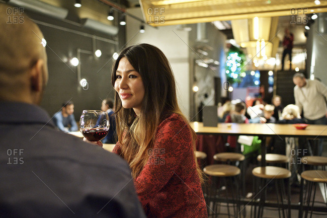 Couple drinking red wine in a restaurant
