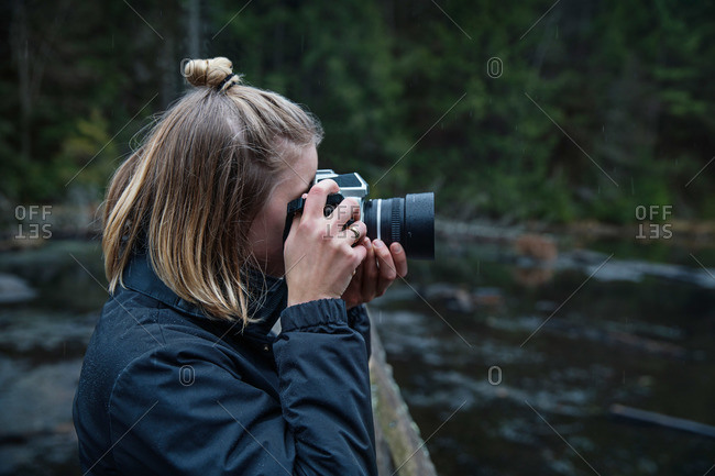 Photographer taking picture by a lake