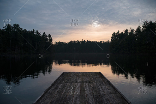 View of lake and forest from a wooden dock