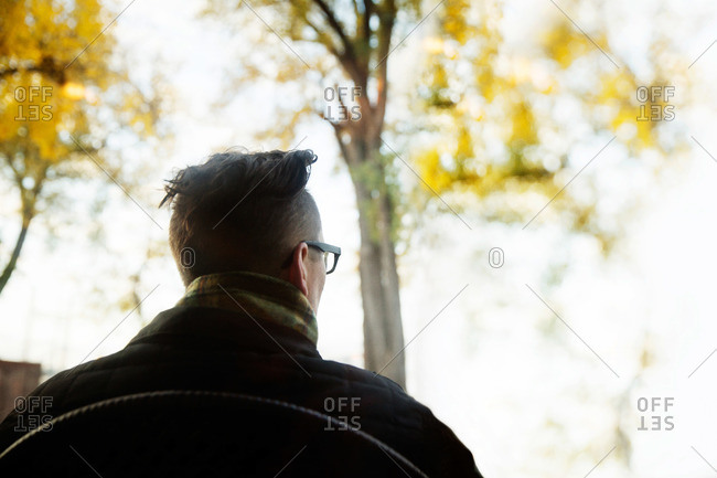 Man sitting outside in the fall