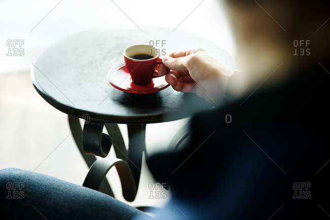 Man with cup of espresso at a cafe