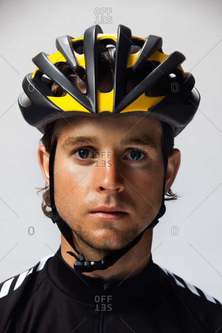 Young man wearing a bicycle helmet