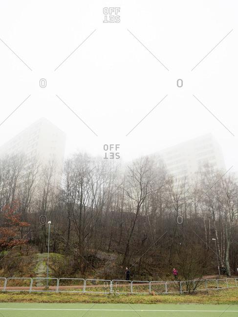 Apartment buildings in fog