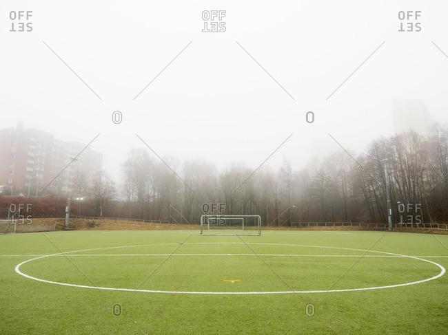 A soccer field in fog