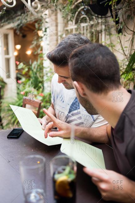Men looking at restaurant menus