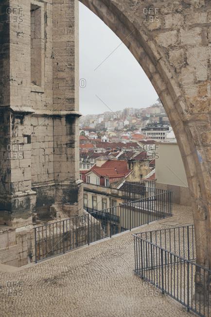 Lisbon neighborhood seen through the arch of an old church