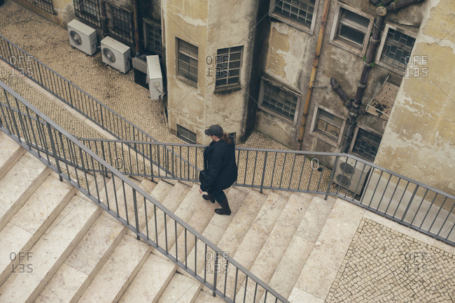 Person walking down a flight of stairs in Lisbon, Portugal