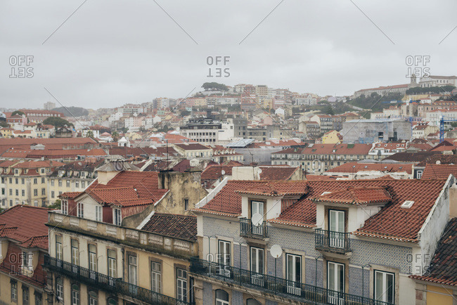 Neighborhood in the city of Lisbon, Portugal with cloudy sky