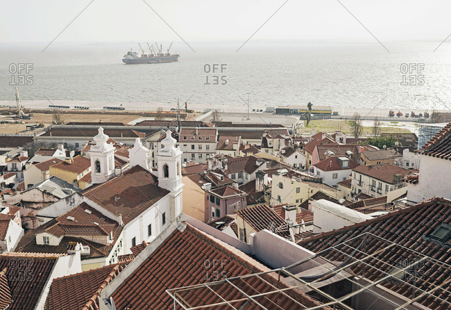 Port and neighborhood in Lisbon, Portugal seen from viewpoint Santa Luzia