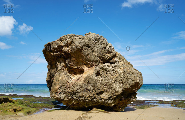 Large boulder on the shore of a beach