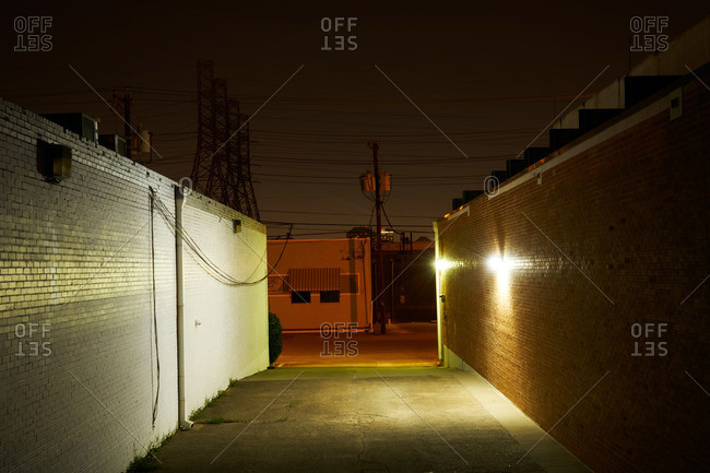 Empty downtown alley at night