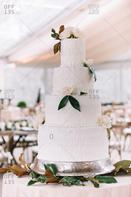 Floral cake in wedding reception hall