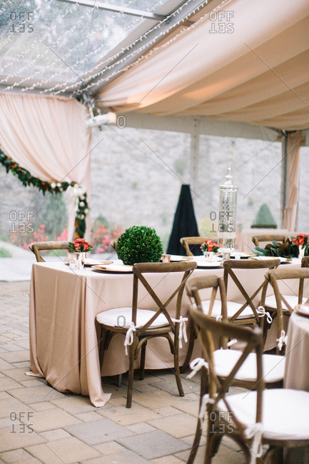 Decorated tables set for wedding reception