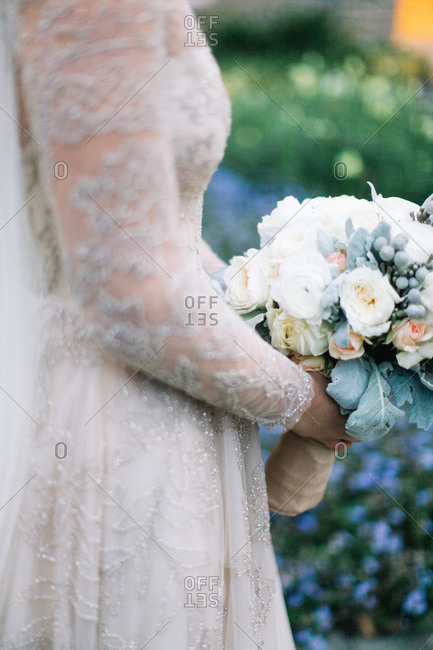 Bride in lace gown holding her bouquet