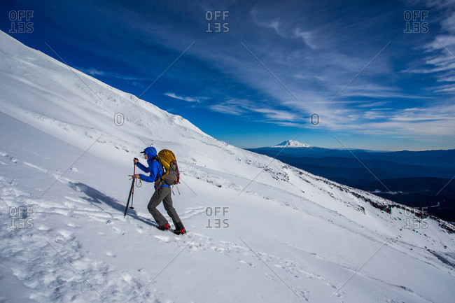 Climber moving uphill through the snow while attempting to summit Mount St. Helens in Washington