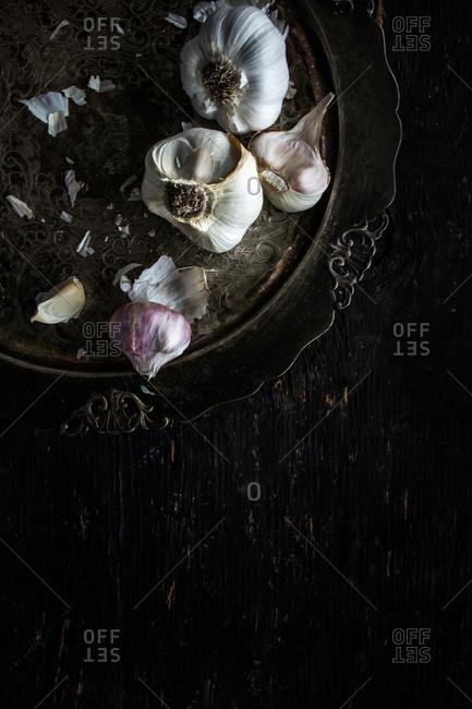 Garlic bulbs on antique platter