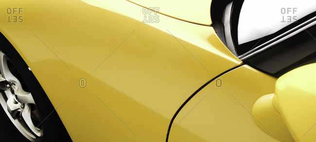 Close up of a yellow sports car's front fender