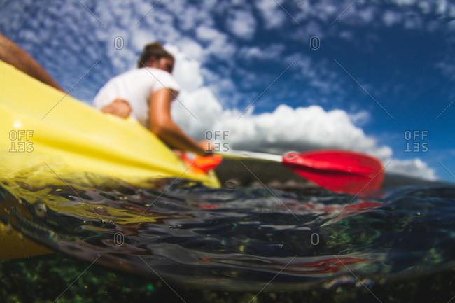 Water shot of a tandem sea kayak in lagoon in Tahiti