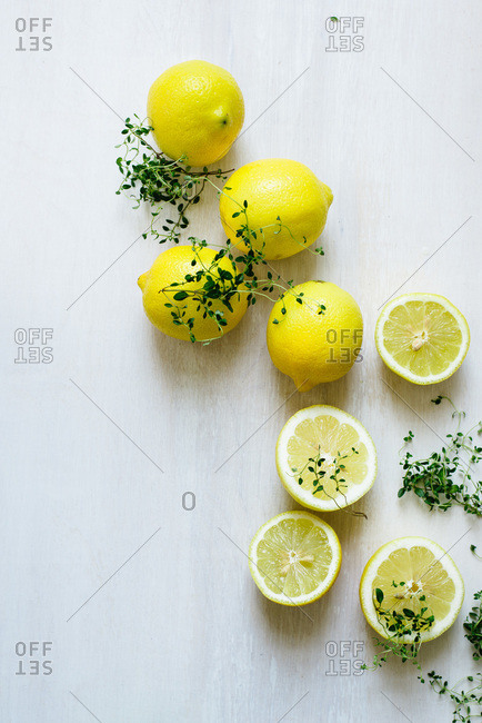 Whole and halved lemons with thyme