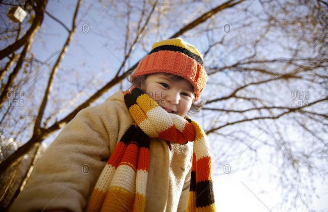 Girl in knit winter wear outside