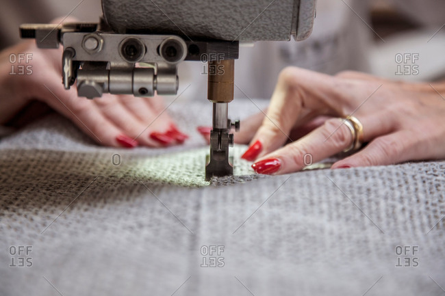 Hands sewing furniture material
