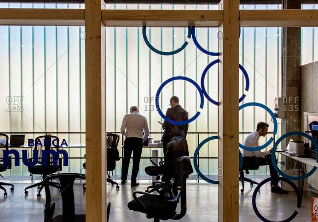 Milan, Italy - October 2015: Coworkers in office in Milan