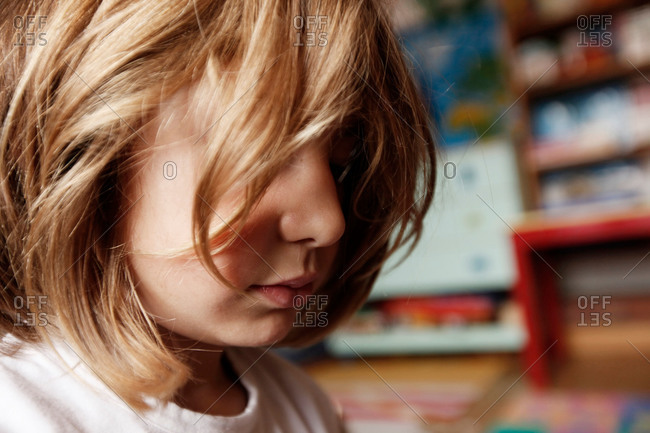 Hair covering girl's face indoors