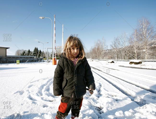 Girl in winter by train tracks