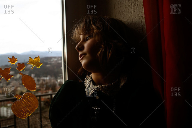 Girl by window with fall stickers