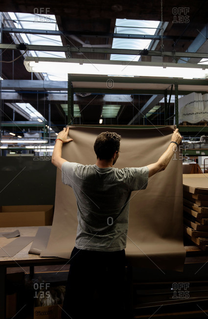Novedrate, Como, Italy - July 20, 2015: Man holding up material for furniture