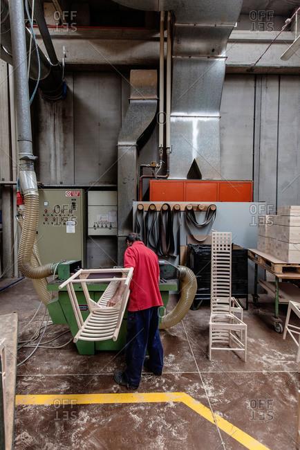 Meda, Brianza, Italy - July 21, 2015: Man making furniture frames