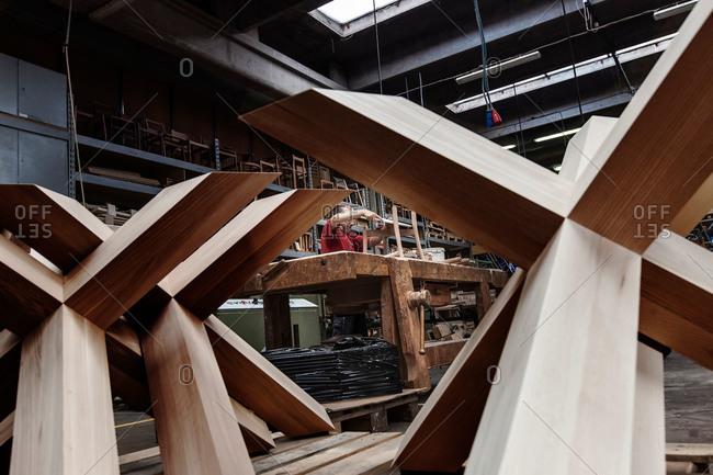 Meda, Brianza, Italy - July 21, 2015: Man at table making furniture frames