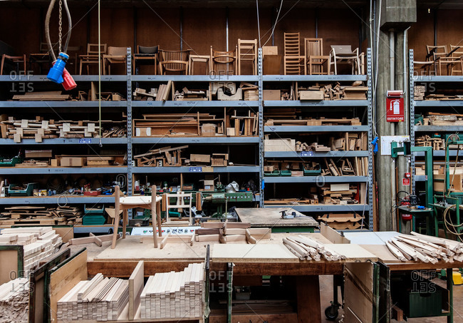 Meda, Brianza, Italy - July 21, 2015: Furniture in various stages in factory