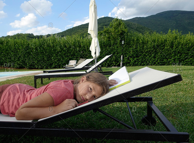 Girl relaxing in countryside, Tuscany