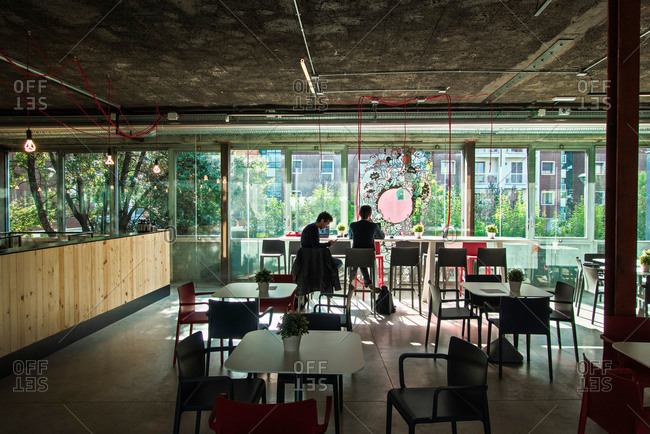 Milan, Italy - October 8, 2015: People in cafe area of office
