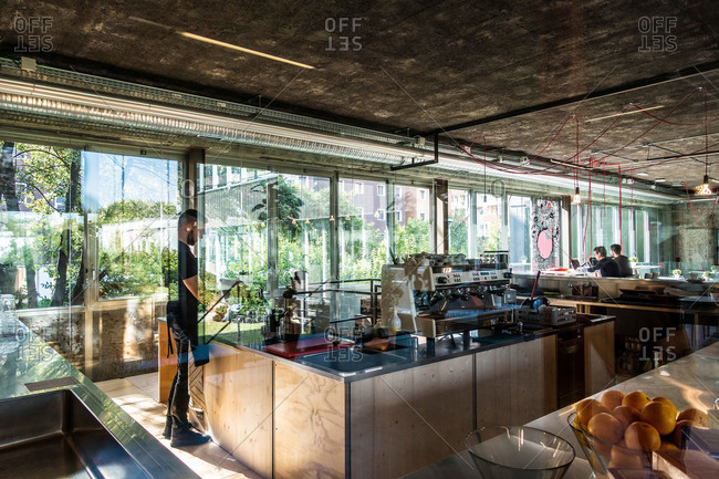 Milan, Italy - October 8, 2015: Barista in office cafe