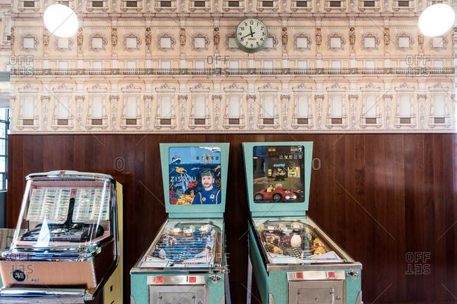 Milan, Italy - October 8, 2015: Pinball machines in art gallery cafe