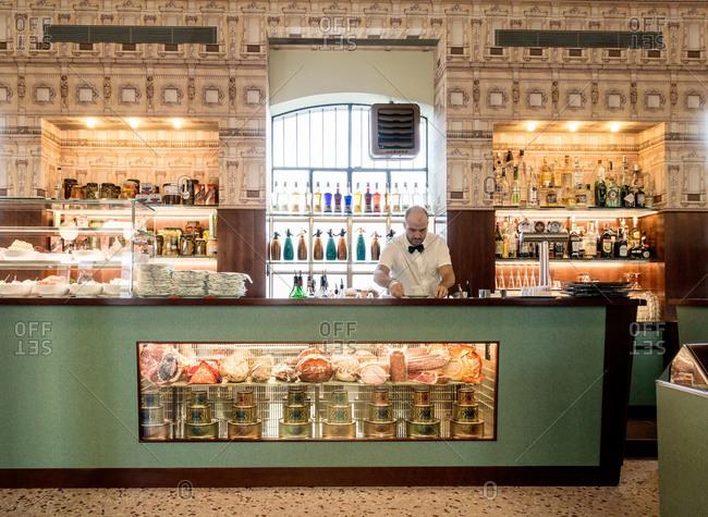 Milan, Italy - October 8, 2015: Server in art gallery cafe