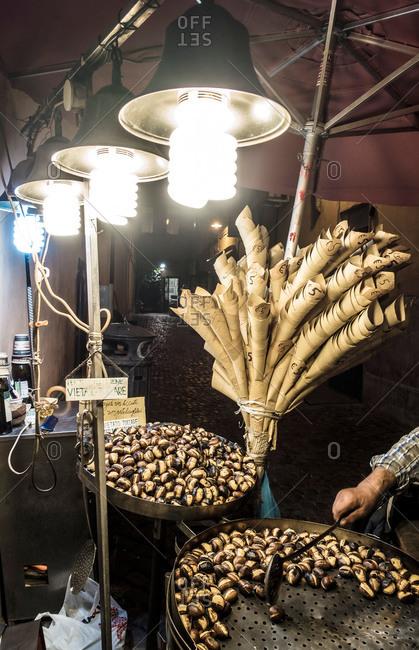 Street vendor stirring chestnuts, Rome