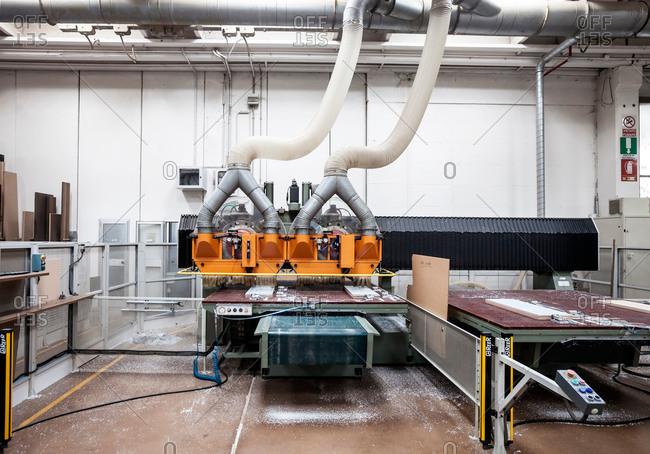 Giussano, Brianza, Italy - July 20, 2015: Machine in Italian furniture factory