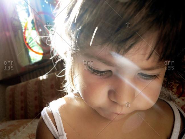 Child in home in sun flare