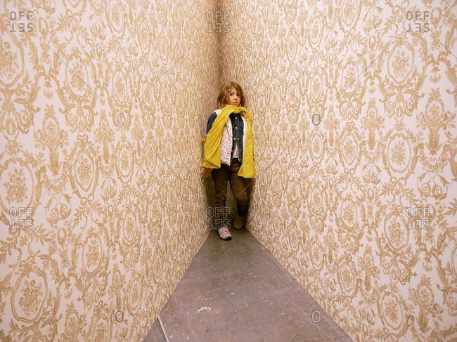 Girl in corner of art exhibit